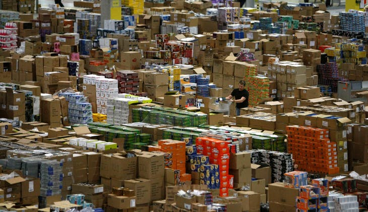 A worker sorts packages at the Amazon warehouse in Leipzig